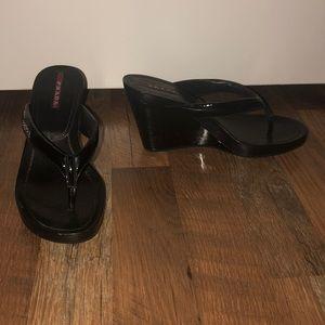 Black high platform open toed Prada's